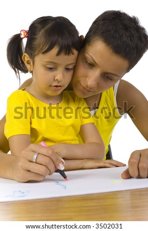 Smiling mother sitting with daughter at desk. Writing something with pink marker. White background - stock photo