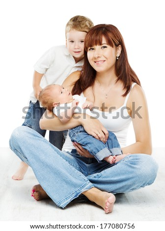 Smiling mother with two kids: son and newborn baby, sitting over white background  - stock photo