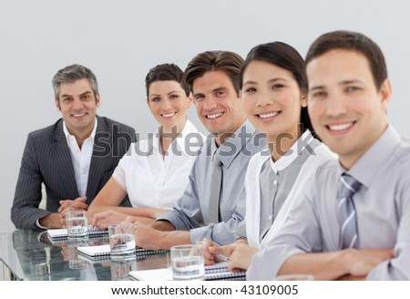 Smiling multi-ethnic business people in a meeting in the office