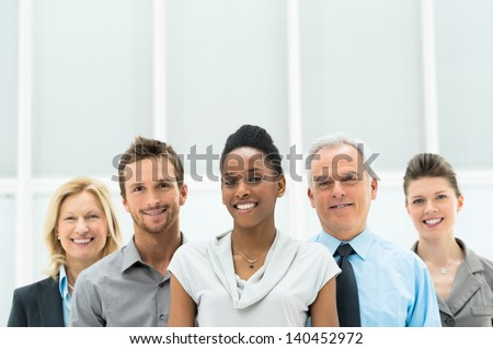 Smiling multi ethnic business team with copy space - stock photo