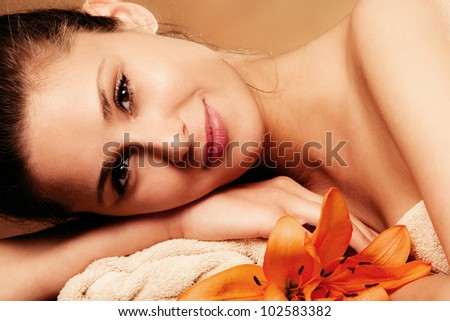 smiling natural beautiful woman in spa salon, relaxing, portrait
