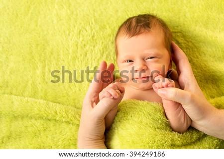 smiling newborn baby - stock photo