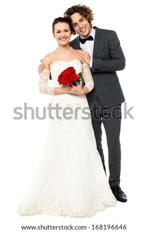 Smiling newlywed couple isolated over white - stock photo