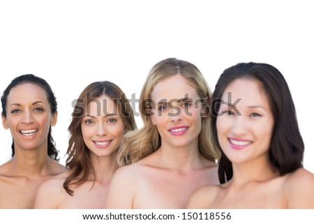 Smiling nude models on white background posing in a line with brunette on background - stock photo