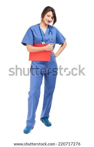 Smiling nurse full length isolated on white - stock photo