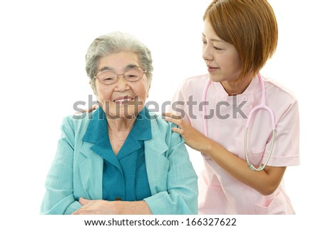 Smiling nurse with old lady