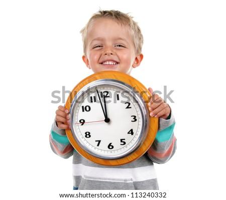 Smiling nursery school child holding a clock - stock photo