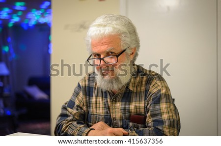 Smiling old man in the kitchen