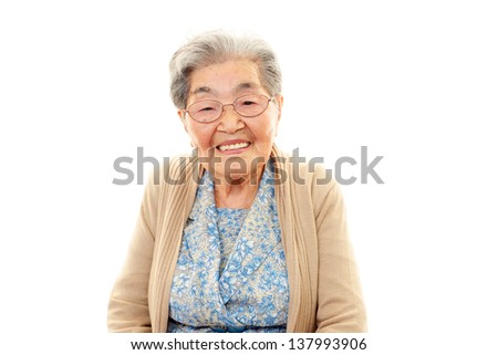 Smiling old woman - stock photo