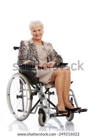 Smiling old woman in her wheelchair - stock photo