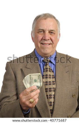 Smiling older businessman in a sports-coat and tie over a white background holding fist full of dollar bills
