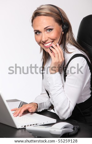 Smiling operator woman in a Call center.