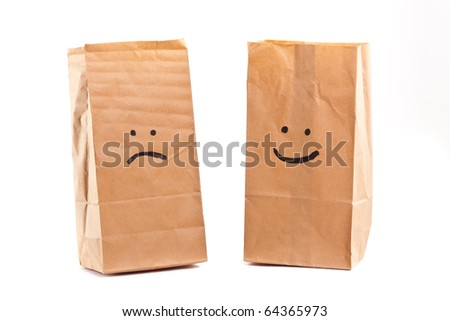 Smiling paper bag. Concept. Isolated on white. - stock photo