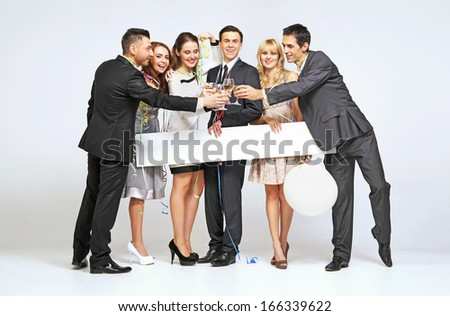 Smiling people celebrating new year - stock photo