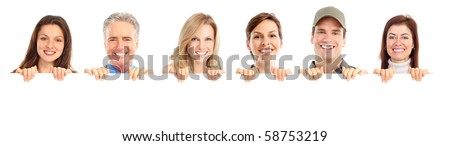 smiling people holding a white placard - stock photo