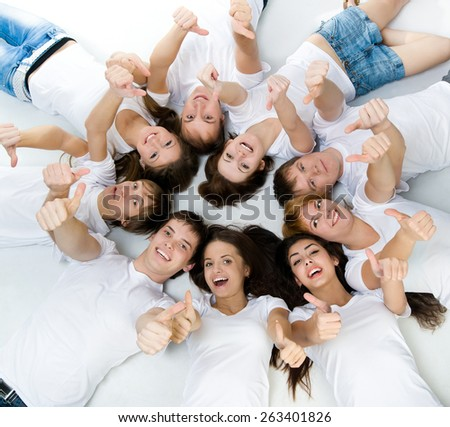 smiling people  lie over white background - stock photo