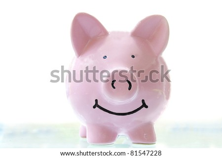 smiling pink piggy bank, on white - stock photo