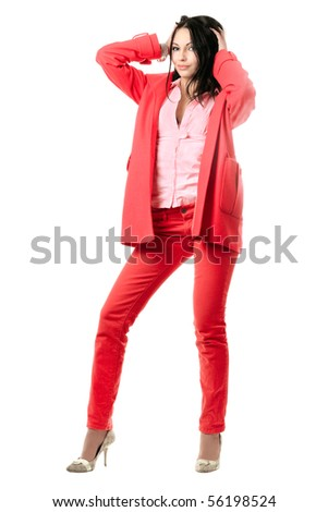 Smiling playful young brunette in red suit. Isolated on white