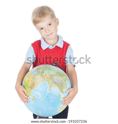 Smiling preschool boy holding a globe on white background