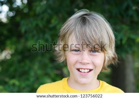 Smiling  preteen boy - stock photo