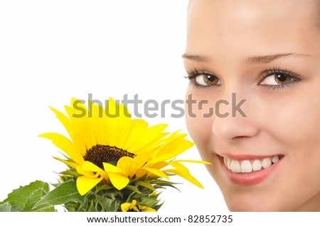Smiling pretty face with bright eyes and a sunflower - stock photo