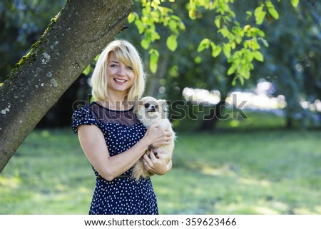 Smiling pretty owned and scared baby dog - stock photo