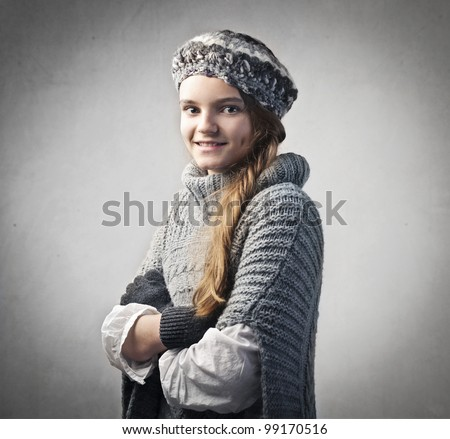Smiling pretty teenage girl in warm clothes - stock photo