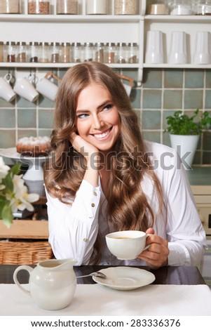 Smiling pretty woman drinking coffee  - stock photo