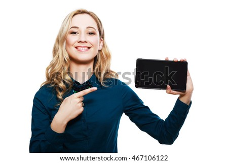 Smiling pretty woman showing blank tablet computer screen isolated on a white background. Looking at camera