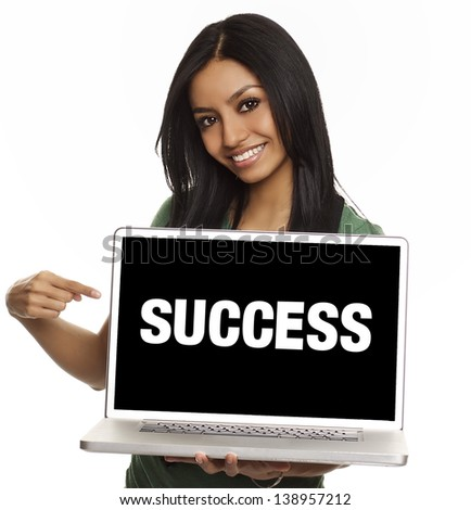 Smiling pretty young woman with friendly happy smile holding a laptop computer and pointing at screen where you add your marketing message - stock photo