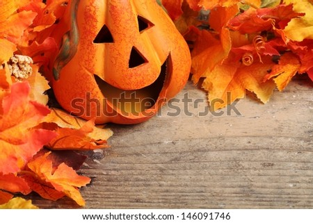 Smiling pumpkin head on wooden background with copy space - stock photo