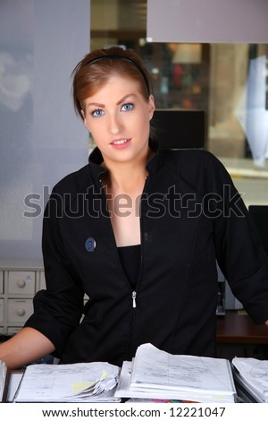 Smiling receptionist welcoming her customers to the beauty salon - stock photo