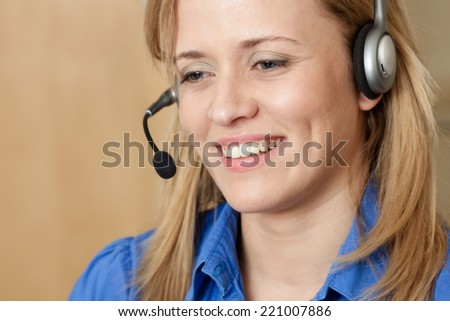 Smiling receptionist woman.