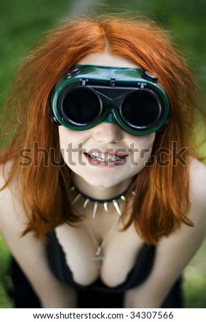 Smiling red haired female portrait.