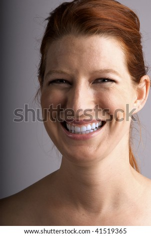 Smiling Red Head Female