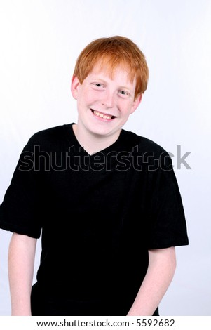 smiling redhaired boy with freckles smiling