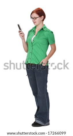 Smiling redheaded girl using a mobile phone while is standing up. - stock photo