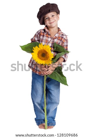 Smiling rural boy standing with sunflower, isolated on white - stock photo