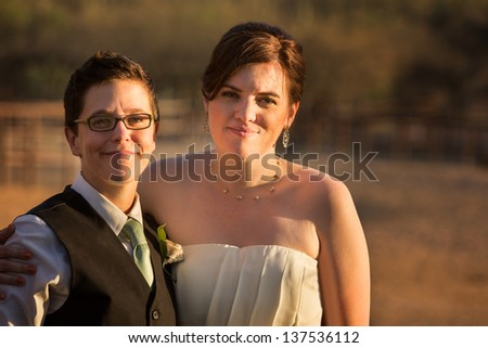 Smiling same sex couple at civil union - stock photo
