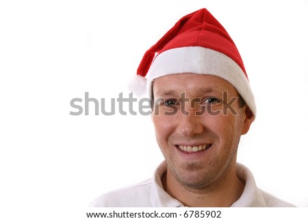 Smiling Santa A young man with a santa claus hat is smiling. Isolated over white! Lots of copyspace to write text in!