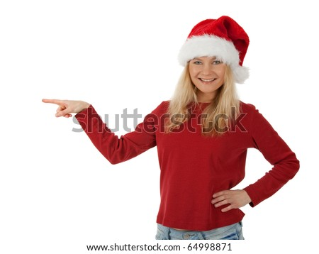 Smiling Santa girl wearing Christmas hat, showing direction. Isolated on white. - stock photo