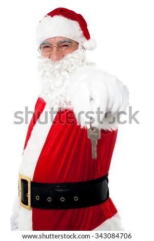 Smiling santa giving key - stock photo