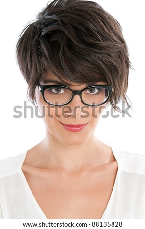 Smiling satisfied beautiful woman looking at camera with her new pair of eyeglasses - stock photo