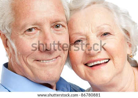 Smiling satisfied senior couple looking together at camera closeup - stock photo