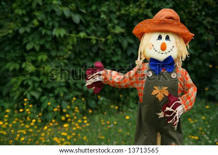 Smiling scarecrow, copy space - stock photo