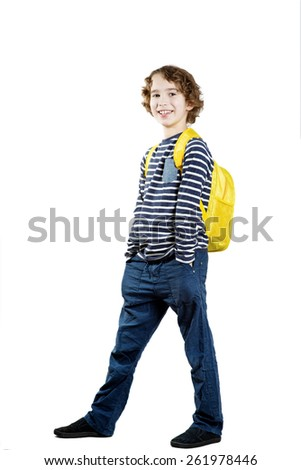 Smiling school boy with backpack isolated on white background - stock photo