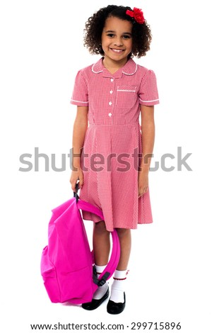 Smiling school girl posing with backpack over white - stock photo