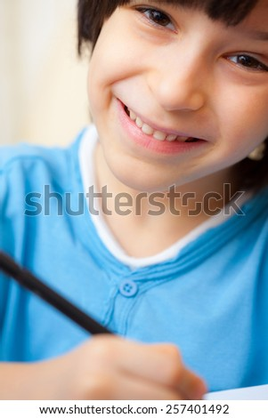 smiling schoole boy with pen, portrait - stock photo