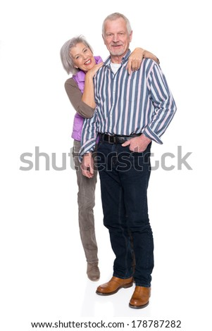Smiling senior couple in front of white background - stock photo