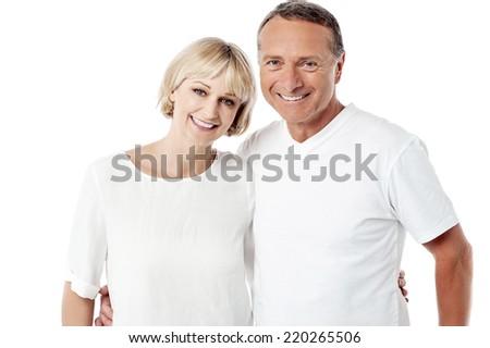 Smiling senior couple posing over white background - stock photo